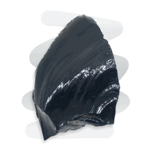 A spear-shaped Black Obsidian volcanic rock with a smooth and glossy finish and razor sharp edges.