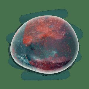 Bloodstone tumble stone, mainly dark greenish-blue with red blotches.