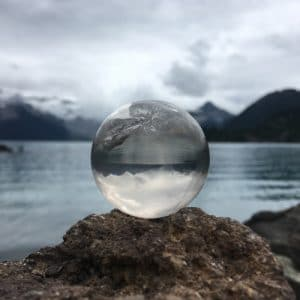 Clear quartz sphere with lake and mountains