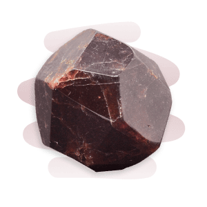 A glass-like deep red Garnet stone with white veins and formed in a dodecahedral shape.