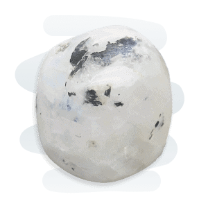 Moonstone tumble stone, primarily white with black patches and a pearly opalescence that reflects a blue flash.