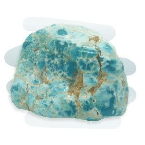 A bright blue-green Turquoise stone in a nodular shape with black cracks and veins.